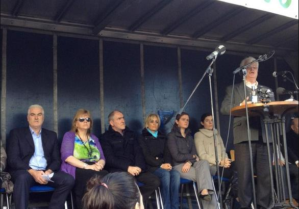 Ben Gilroy on platform with the Quinn family, Mickey Harte and others at Cavan protest last year